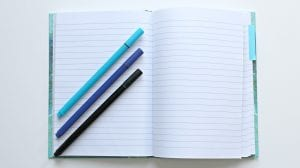 Pens over a notebook