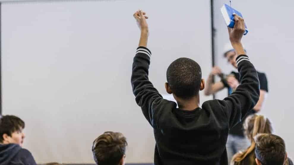 Boy in front of white board